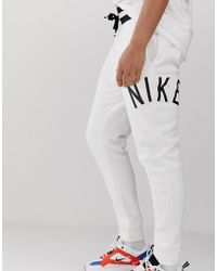 check out 89071 08d17 Nike - Air Logo Joggers White - Lyst