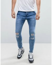 Illusive London - Super Skinny Jeans With Distressing - Lyst