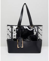Yoki Fashion - Plastic Tote With Black Stars - Lyst