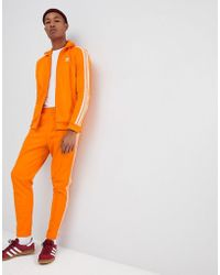 adidas Originals - Beckenbauer Joggers In Orange Dh5819 - Lyst