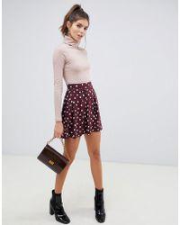 d43cd84fd2 ASOS - Mini Skirt With Box Pleats In Burgundy Polka Dot - Lyst