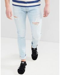 Hollister - Skinny Distressed Ripped Jeans In Light Wash - Lyst