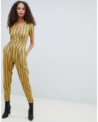 2ccb86261e3 ASOS - Wrap Front Jersey Jumpsuit With Short Sleeve In Stripe Print - Lyst