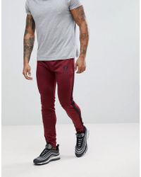 Gym King - Logo Skinny Poly Joggers In Burgundy With Side Stripes - Lyst