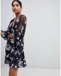 Liquorish - Bird And Floral Print Wrap Mini Dress With Mesh Sleeves - Lyst