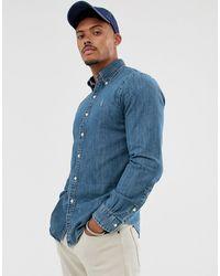 Polo Ralph Lauren Chemise ajustée en jean avec logo joueur de polo - Bleu