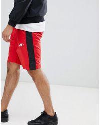 Nike - Pantalones cortos rojos de tejido con logo 927994-657 - Lyst