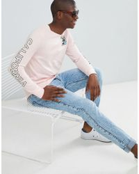Hollister - Colour Change Floral Logo Long Sleeve Top In Pink - Lyst
