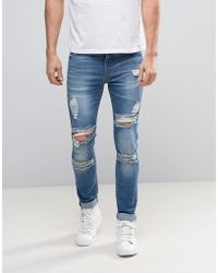 ASOS - Super Skinny Jeans With Mega Rips In Mid Blue - Lyst
