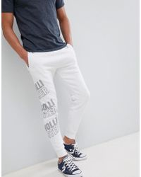 Hollister - All Over Print Logo Super Skinny Joggers In White - Lyst