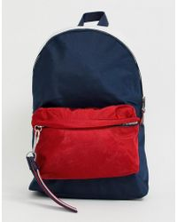 203e5802be Tommy Hilfiger - Detachable Logo Tassle Backpack With Red Front Pocket In  Navy - Lyst