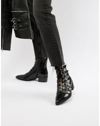 E8 - E8 By Miista Tuva Black Leather Multi Buckle Flat Boots - Lyst