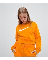 Nike Sweat-shirt court avec grand logo virgule en exclusivité ASOS - Orange