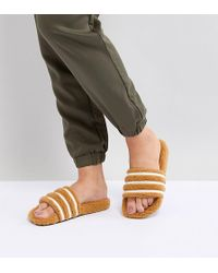 adidas Originals - Adilette Furry Slider Sandals In Tan - Lyst