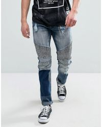 Reason - Biker Jeans In Mid Wash With Distressing And Patch - Lyst