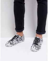 ASOS - Lace Up Trainers With Graffiti Print - Lyst