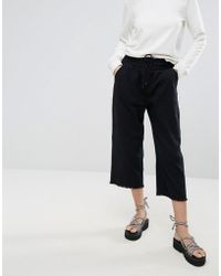 Cheap Monday - Flow Cropped Denim Joggers - Lyst
