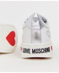 Love Moschino - Baskets cloutes avec logo - Lyst