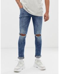86b9fd884a ASOS - Recycled Super Skinny Jeans In Acid Wash Blue With Busted Knees -  Lyst