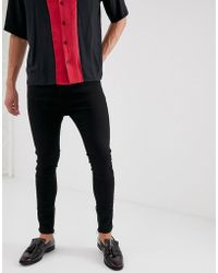 Religion - Drop Crotch Skinny Jean With Ripped Back In Black - Lyst
