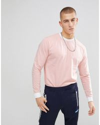 ASOS - Oversized Long Sleeve T-shirt With Contrast Ringer And Contrast Cuff - Lyst