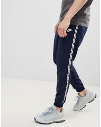 Nike - Taping Skinny Fit Joggers In Navy Ar4912-451 - Lyst