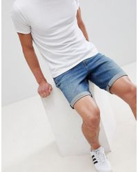 ASOS DESIGN - Denim Shorts In Slim Mid Wash With Abrasions - Lyst