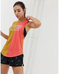 36b7ef4ff2915 Nike - Gold And Pink Colourblock Miler Tank - Lyst