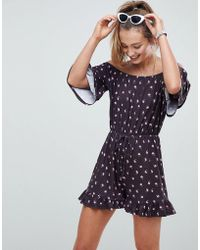ASOS - Off Shoulder Jersey Playsuit With Frill Hem In Ditsy Print - Lyst