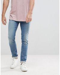 Calvin Klein - Light Wash Slim Jeans - Lyst
