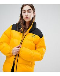 9b8355c64c3d Converse - Oversized Exclusive Yellow Padded Jacket - Lyst