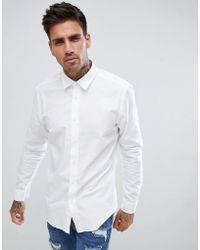 ef39d5b4c0 HUGO - Camisa blanca con logo en el pecho de - Lyst