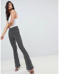 7469c799988a9 ASOS Asos Design Petite Kick Flare leggings In Pinstripe in Black - Lyst