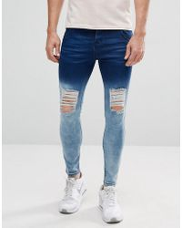 Illusive London - Super Skinny Jeans With Blue Fade And Distressing - Lyst