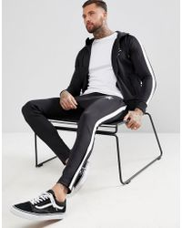 Gym King - Skinny Poly Joggers In Black With Side Stripe - Lyst