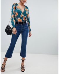 Missguided - Cropped Flare Jeans - Lyst
