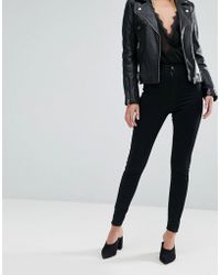 River Island - Molly Mid Rise Skinny jeggings In Black - Lyst