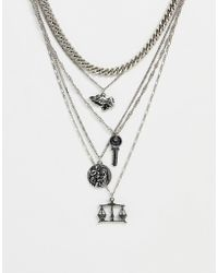 ASOS - Layered Multi Chain Pack With Coins And Praying Hands In Burnished Silver Tone - Lyst
