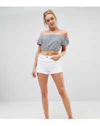 ASOS - Asos Design Tall Denim Alvey Mid Rise Short With Raw Hem In White - Lyst