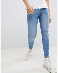Pull&Bear - Carrot Fit Jeans In Blue Wash - Lyst