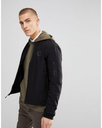 Timberland - Soft Shell Bomber Jacket Back Logo In Black - Lyst