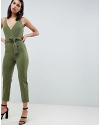 38fa6c3486c ASOS - Wrap Front Jumpsuit With Peg Leg And Self Belt - Lyst