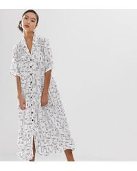 38dfc50e2e23 Monki - Face Print Buttoned Midi Dress With Pockets In White - Lyst