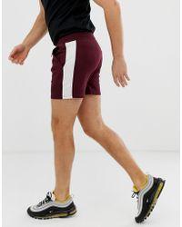 ASOS - Pantalones extracortos ajustados de punto burdeos con raya lateral de - Lyst