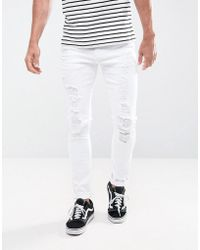 ASOS DESIGN - Super Skinny Jeans In White With Extreme Rips - Lyst