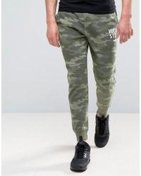 Hollister - Slim Fit Cuffed Jogger Burnout Camo Print In Green - Lyst
