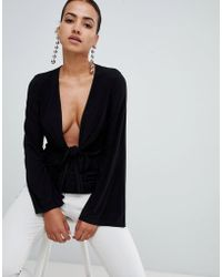 Club L - Long Sleeve Tie Front Plunge Top - Lyst