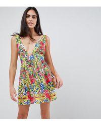 73f00f83c1 ASOS Mixed Tile Print Cross Neck Split Maxi Beach Dress in Green - Lyst