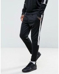 Illusive London - Skinny Track Joggers In Black With Taping - Lyst