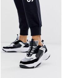 Calvin Klein Chunky sneakers en blanco y negro Marvin